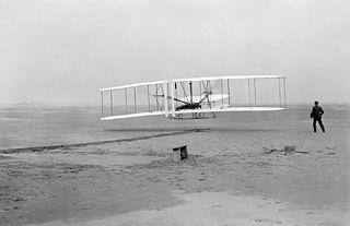 first heavier-than-air powered flight