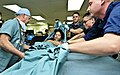Flickr - Official U.S. Navy Imagery - Service members from the U.S. Navy and Australian army help lift a Filipino women onto a bed in the intensive care unit..jpg