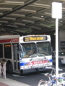 A New Flyer D60LF Route 23 bus passing under the Pennsylvania Convention Center arcade in 2006