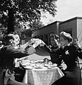 Four friends raise their tea cups in a toast to celebrate an afternoon's fun in Hyde Park, London during their 'stay at home holiday' in 1943. D16029.jpg