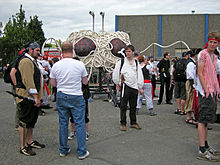 various people standing around a small Flying Spaghetti Monster Parade float.