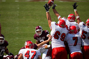 Field goal - The Fresno State Bulldogs block a Texas A&M field goal attempt.