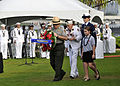 From front left, a National Park Service employee, a Pearl Harbor survivor, a U.S. Coast Guardsman and a student from the Navy Hale Keiki School present a wreath during a Pearl Harbor 71st anniversary 121207-N-DB801-276.jpg