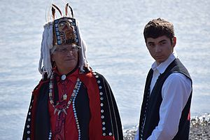 Haida people - A Haida hereditary leader of the eagle moiety awaits guests with his nephew on the shores of his territory.