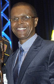 Gale Sayers giving a speech in 2008