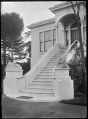 Grand entrance stairway leading to a front door, flanked with two lions on plinths, at a private house in Dunedin. ATLIB 289944.png