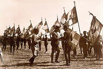 Greco-Turkish War (1919–1922) - King Constantine decorating the victorious war flags outside Kütahya, 1921