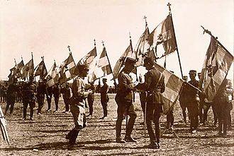 Constantine I of Greece - Constantine decorating regimental war flags of the Greek Army after the Battle of Kütahya-Eskişehir, during the Greco-Turkish War (1919–1922).