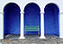 Green bench, blue walls, white arches and columns (Portmeirion).jpg