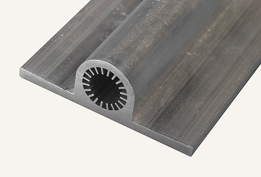 Axial Grooved Aluminum Extrusion for Spacecraft Heat Pipes