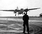 Grumman C-1A Trader landing aboard USS Coral Sea (CVA-43), circa in 1975.jpg