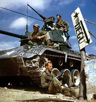 Korean War - Crew of an M-24 tank along the Nakdong River front, August 1950