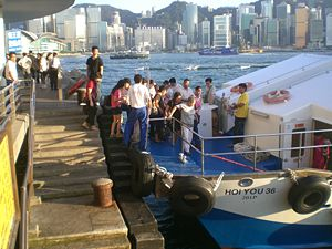 Kowloon Public Pier - Passengers boarding a boat at the pier