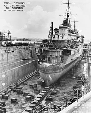 HMS Liverpool (C11) - HMS Liverpool in dry dock at Mare Island Naval Shipyard, 26 June 1941.  The ship is fitted with a provisional false bow.
