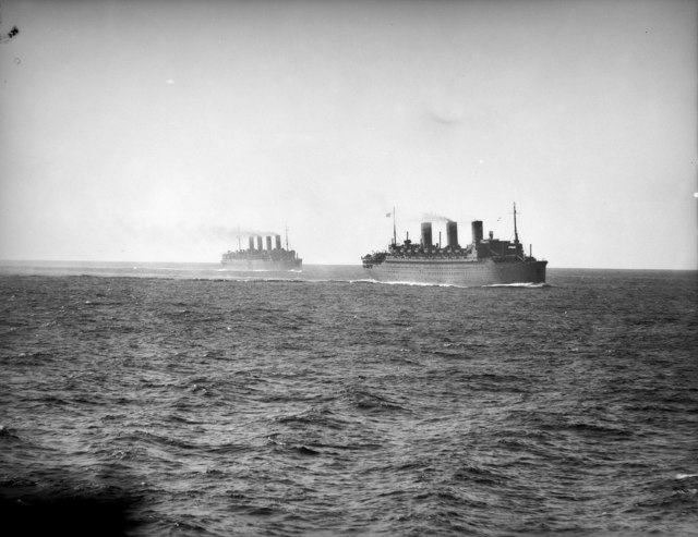 Aquitania (at left) and Île de France during Operation Pamphlet