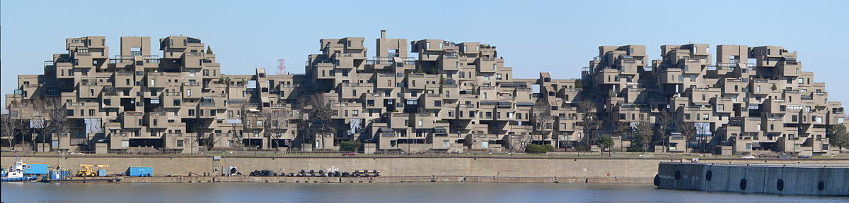 A wide image showing a complete view of Habitat 67 as seen from the port.