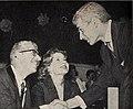 Harry Karl and Rhonda Fleming congratulate Jeff Chandler, 1955.jpg