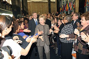 United States Department of State - Secretary of State Hillary Clinton is greeted by Department employees during her arrival on her first day.