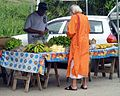 Hindu Holy Man makes purchases at produce market, Debe, Trinidad and Tobago..JPG
