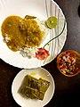 Homemade dal and rice meal with Bhetki paturi and salad.jpg