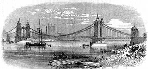 Chelsea Bridge - The first Chelsea Bridge as seen from Battersea in 1858, shortly after opening. The Victoria Tower of the Palace of Westminster is shown under construction in the background.