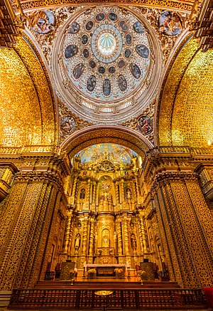 Main altar of the Church of the Society of Jesus (La Iglesia de la Compañía de Jesús), a Jesuit church in Quito, Ecuador. The exterior doesn't give an idea of the beauty of the interior, with a large central nave, which is profusely decorated with gold leaf, gilded plaster and wood carvings, making of it the most ornate church in Quito. The temple is one of the most significant works of Spanish Baroque architecture in America and considered the most beautiful church in Ecuador.