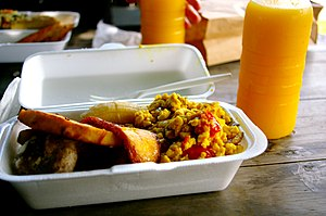Ital -  A Jamaican Ital breakfast consisting of ackee, plantain, boiled food, breadfruit, and mango-pineapple juice.