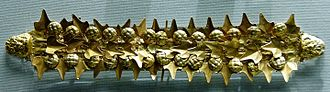 Wreath - Wreath with ivy leaves and berries, a satyr's head at either end. Gold sheet, Etruscan artwork, 400–350 BC. From a tomb near Tarquinia.