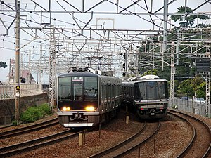 San'yō Main Line - 321 series and 223-1000 series EMUs on a 4-track section in Kobe