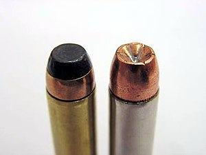 Soft-point bullet - .357 Magnum rounds. Left: Jacketed Flat/Soft Point (JFP/JSP). Right: Jacketed Hollow Point (JHP). JSP is a semi-jacketed round as the jacket does not extend to the tip. Note the notches on the tip of the JHP which assist in the expansion of the bullet on impact with soft tissue.
