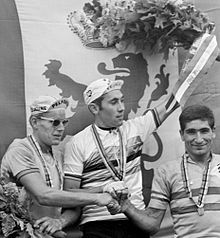 Three cyclists on a podium.