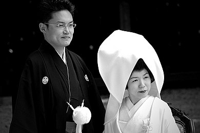 Japanese men traditionally wear a black kimono with some white decoration on their wedding day Japanese Wedding Day.jpg