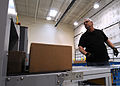 Jeffery Brown, with the 50th Logistics Readiness Flight, puts packages inside a X-ray machine to check for illegal items at the secure area logistics facility at Schriever Air Force Base, Colo 130115-F-OT300-315.jpg