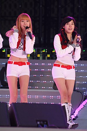 Jessica Jung - Jung and fellow Girls' Generation member Tiffany Hwang on stage together in 2010.