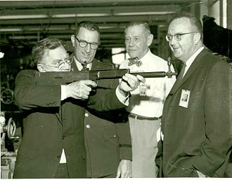 John Garand - Image: John C. Garand shouldering his final advanced rifle design, the T31 Bullpup
