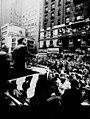 John F. Kennedy, at the street-side podium, campaigns for ILGWU support with David Dubinsky at his side. (5279397068).jpg
