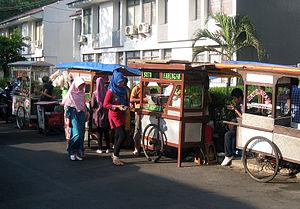 http://upload.wikimedia.org/wikipedia/commons/thumb/e/e3/Kakilima_street_vendors_in_Jakarta.jpg/300px-Kakilima_street_vendors_in_Jakarta.jpg