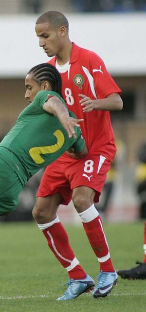 Karim El Ahmadi - El Ahmadi attempted tackling on Benoît Assou-Ekotto during a match against Cameroon.