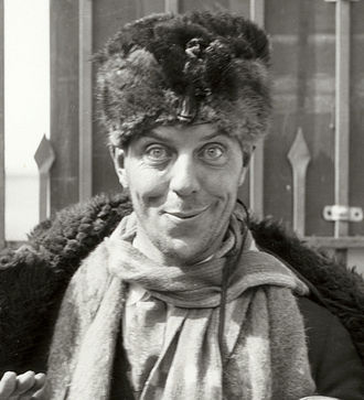 Karl Dane - Dane in a publicity still taken at the gates of the MGM studio (1927)