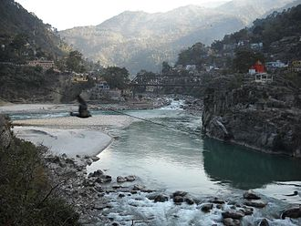 Karnaprayag - The Alaknanda River flowing in from the left meets the Pindar River (center background) to flow on as the Alaknanda again (foreground) at Karnaprayag