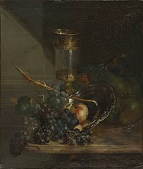 Still life with glass goblet and grapes on a marble table