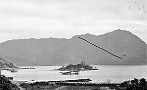 Hoi Sham Island - Hoi Sham Island photographed by John Thomson in 1870. Kowloon Peak is visible in the background.