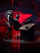 """Gaga biểu diễn """"Government Hooker"""" trong chuyến lưu diễn Born This Way Ball (2012–2013)."""