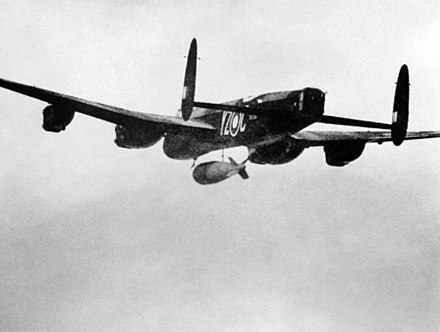 A RAF Avro Lancaster with a 22,000-pound (10,000 kg) Grand Slam bomb, 1945. Lancaster 617 Sqn RAF dropping Grand Slam bomb on Arnsberg viaduct 1945.jpg