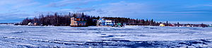 Yellowknife - April 28, 2012 on Yellowknife Bay. The surface melt begins to make transportation more difficult to and from the houseboats near Jolliffe Island.