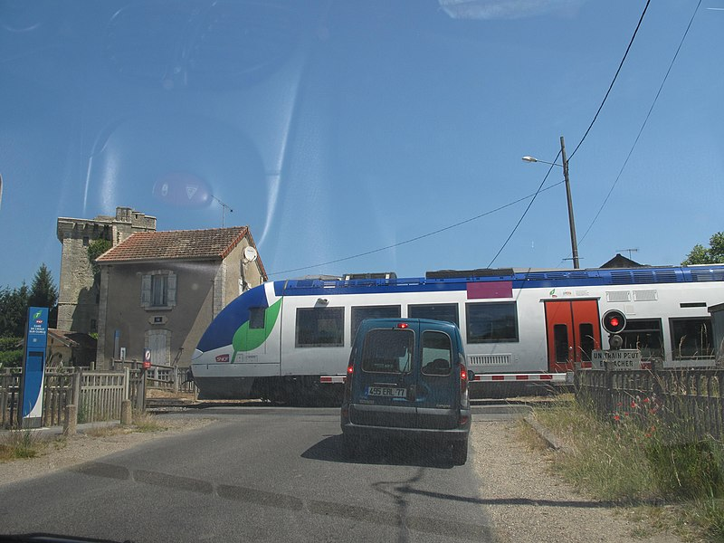 Level crossing in front of the chateau du Houssoy at Crouy-sur-Ourcq (Seine-et-Marne, France)