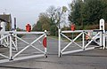 Level crossing gates closing, Wansford station - geograph.org.uk - 1563483.jpg