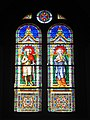 Levico Terme, chiesa del Santissimo Redentore - Vetrate laterali - Santi Vittore e Corona.jpg