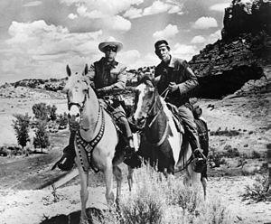 Jay Silverheels - Clayton Moore as the Lone Ranger and Jay Silverheels as Tonto. Moore is riding Silver, while Silverheels is riding Scout.