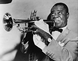 Louis Armstrong's stage personality matched his flashy trumpet. Armstrong is also known for his raspy singing host.